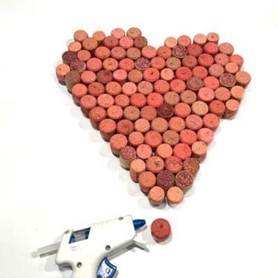 Adding hot glue to wine cork heart edges