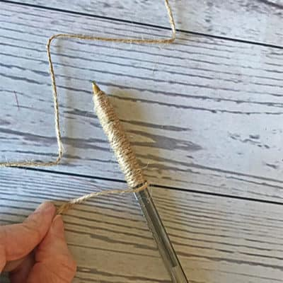 Wrapping pen with twine