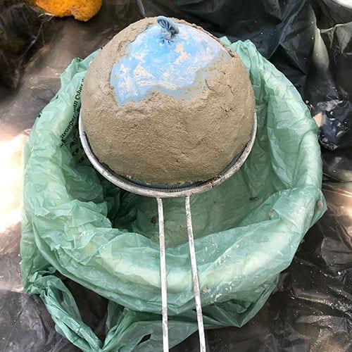 cement molded around balloon