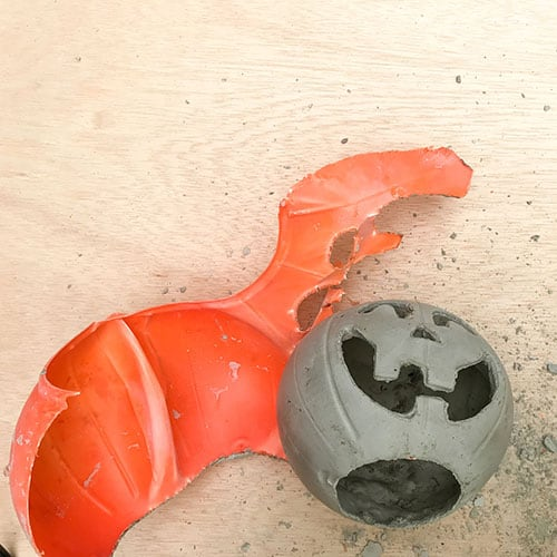 remove plastic from  diy cement jack o' lantern