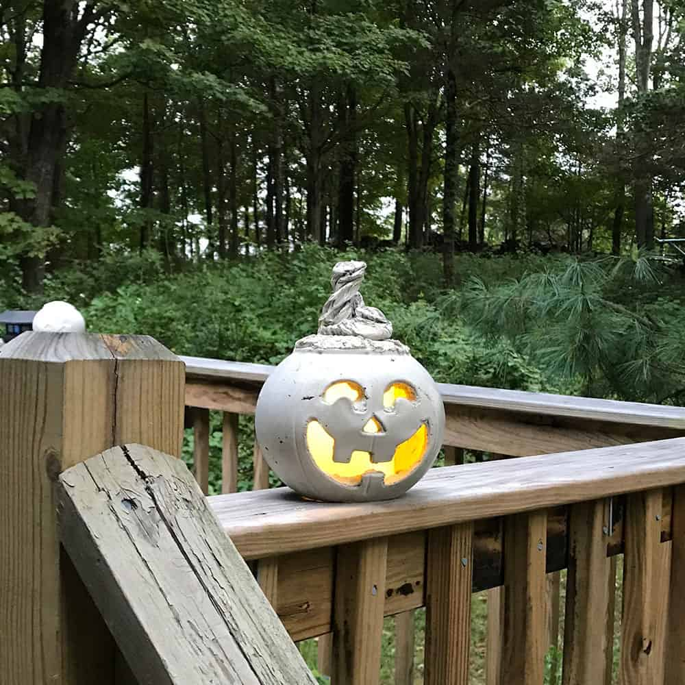 halloween pumpkin with light on railing