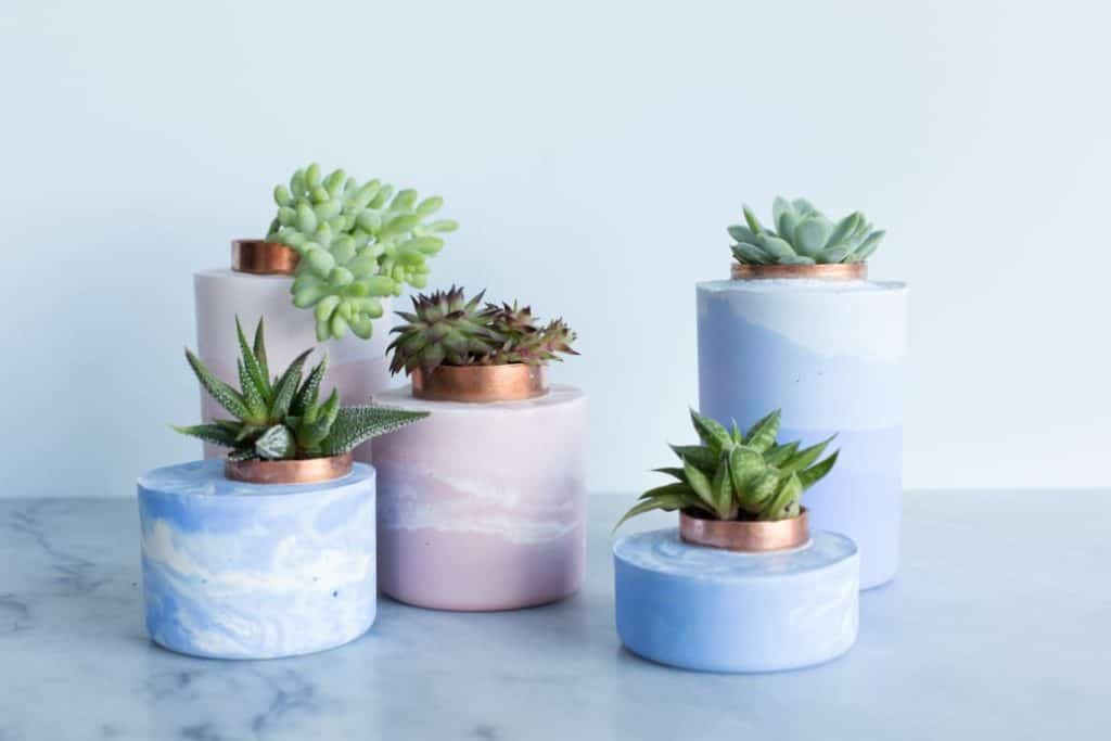 A handmade concrete gift idea- marbled concrete planters