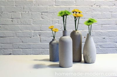 concrete bud vases with flowers