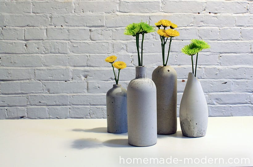 concrete bud vases with flowers as handmade gifts