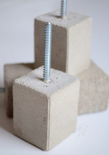A wall hook made of concrete and a screw