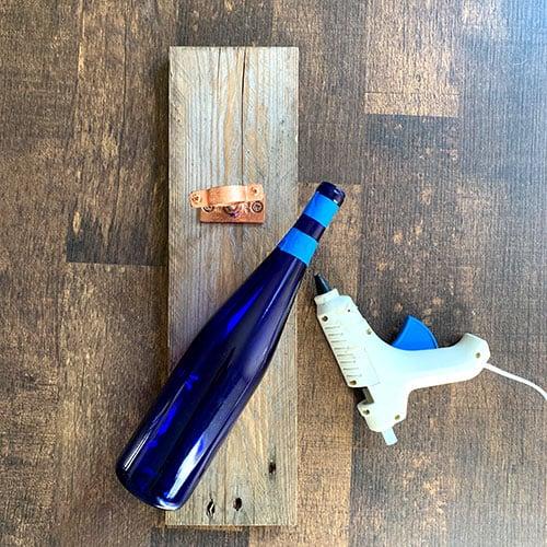 Glue gun and wine bottle