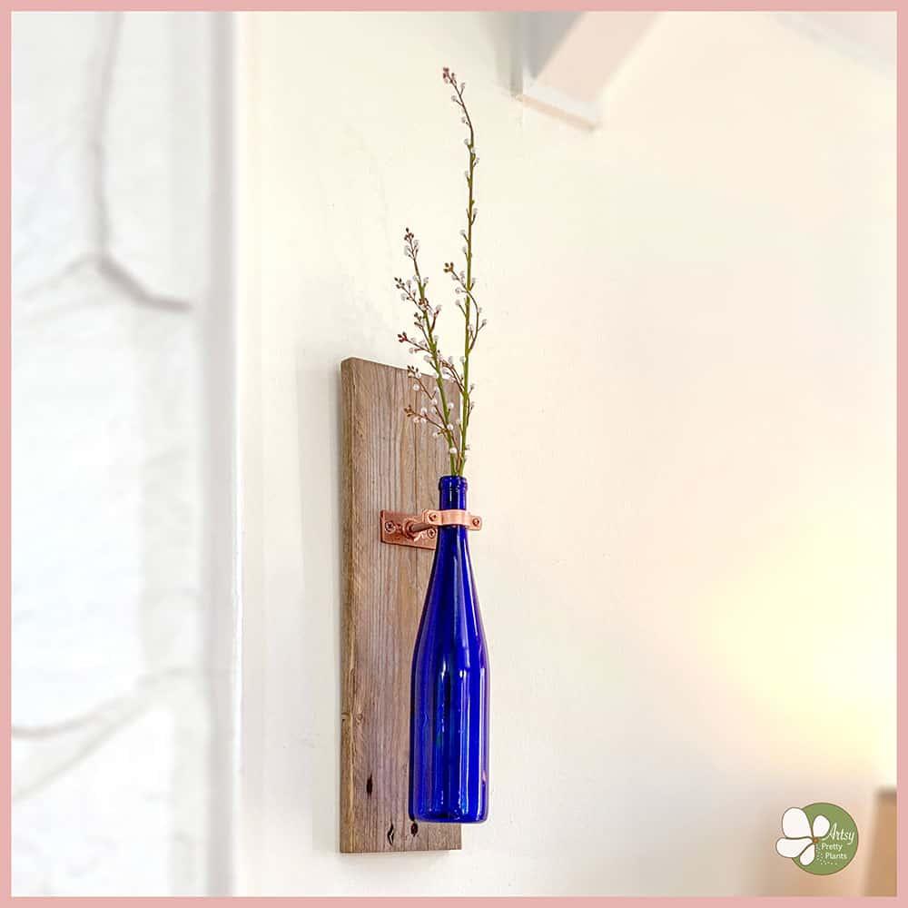 blue bottle on wall