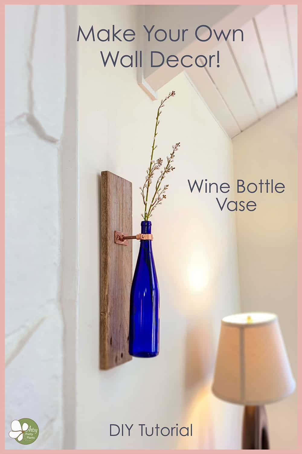 wine bottle on wall as vase