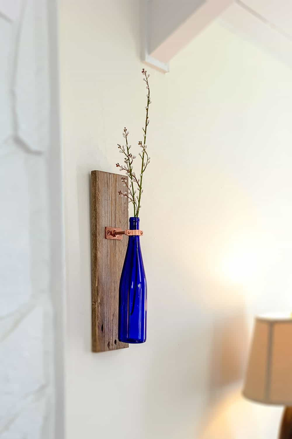 wine bottle on wall with flowers