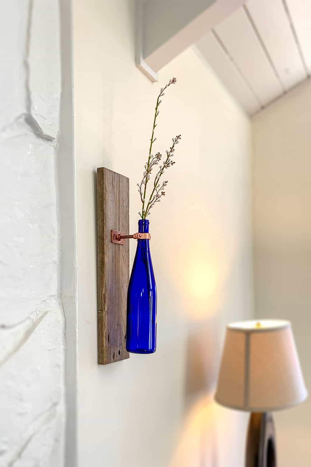 wine bottle as wall sconce