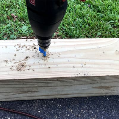 drilling the branch holes for privacy fence