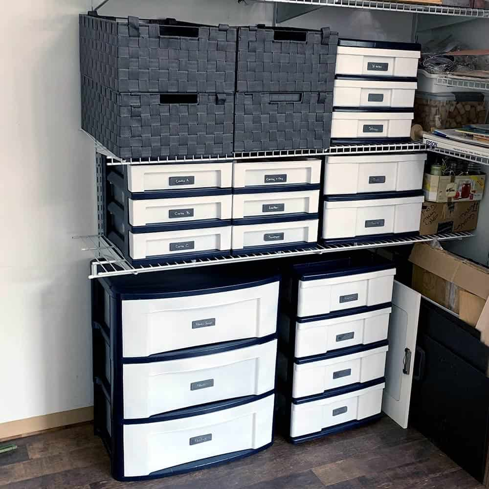 Neat looking plastic drawers that are pained all the same colors with frames in dark navy and the drawers have been painted white