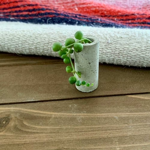 tiny planter made with cement in shape of a wine cork