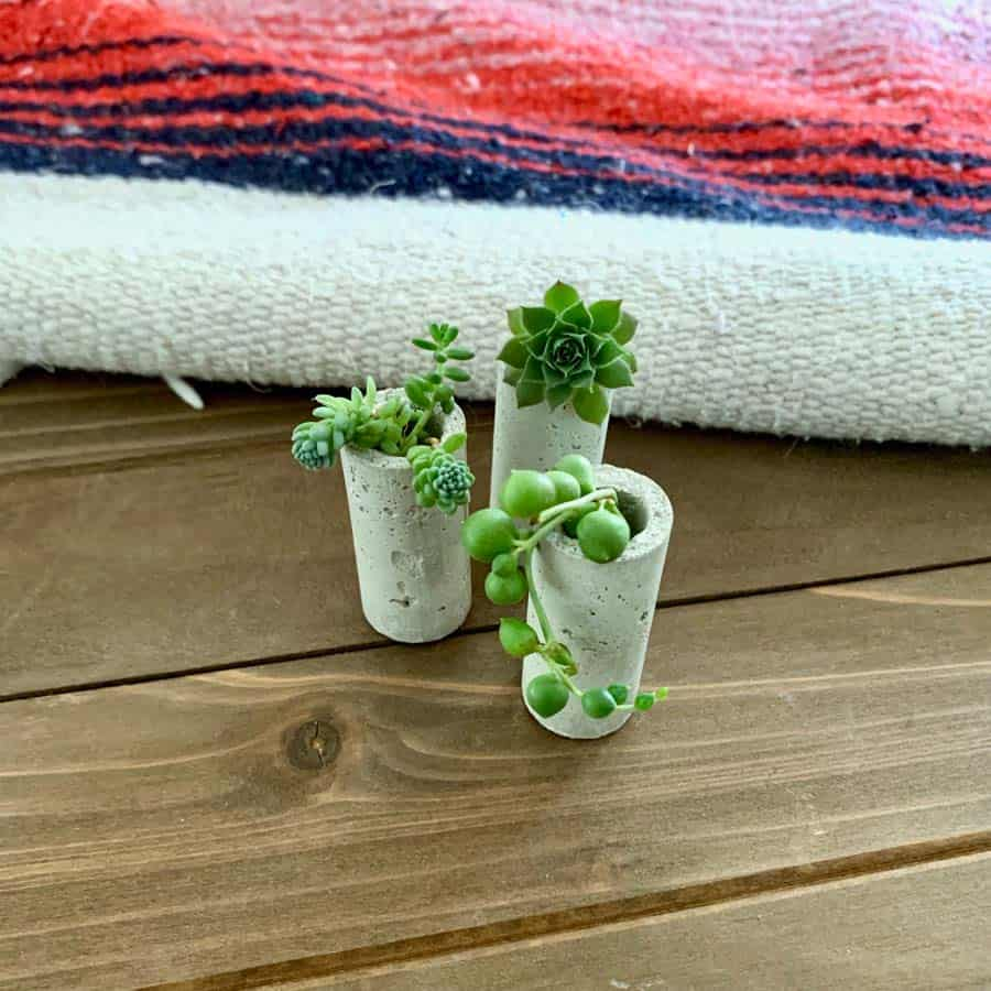 Concrete Wine Cork Planters on wood