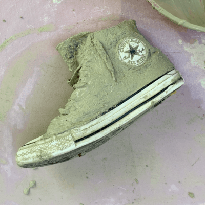 sneaker with cement converse logo