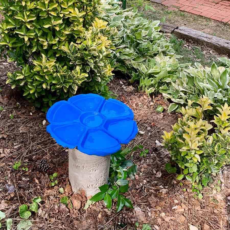 blue bird bath made with cement