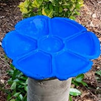 blue bird bath made with cement