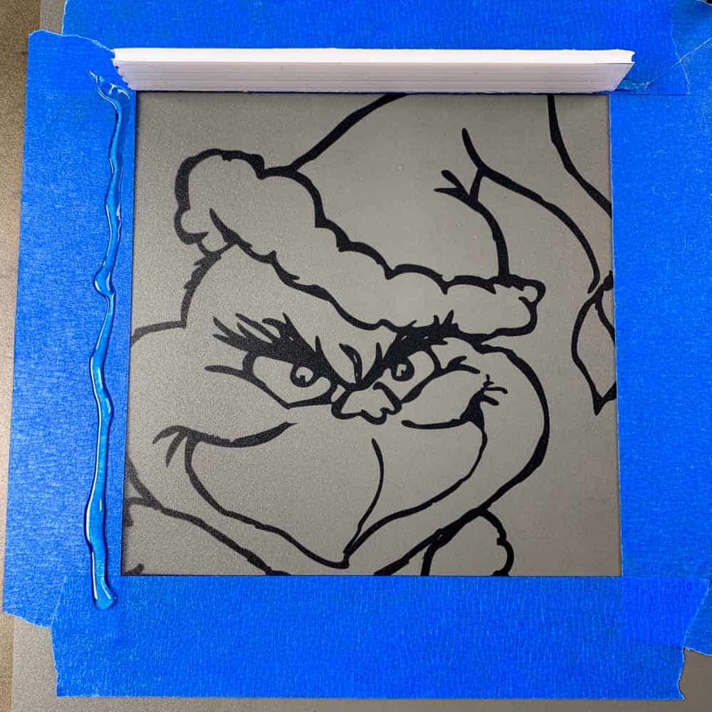 grinch with glue and plastic wall mold