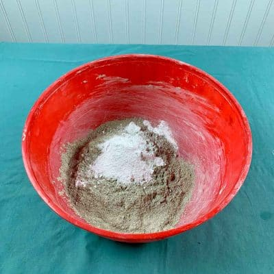 white pigment in cement mix and bowl