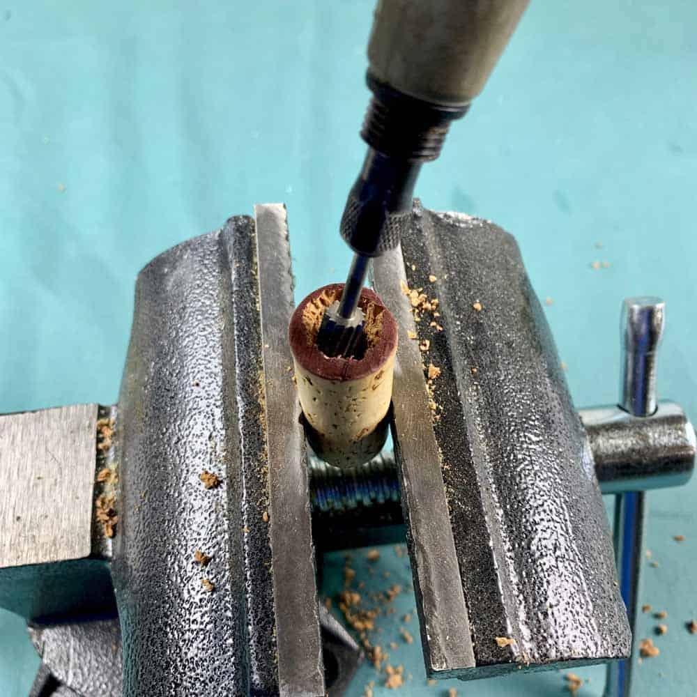 vise holding cork being drilled