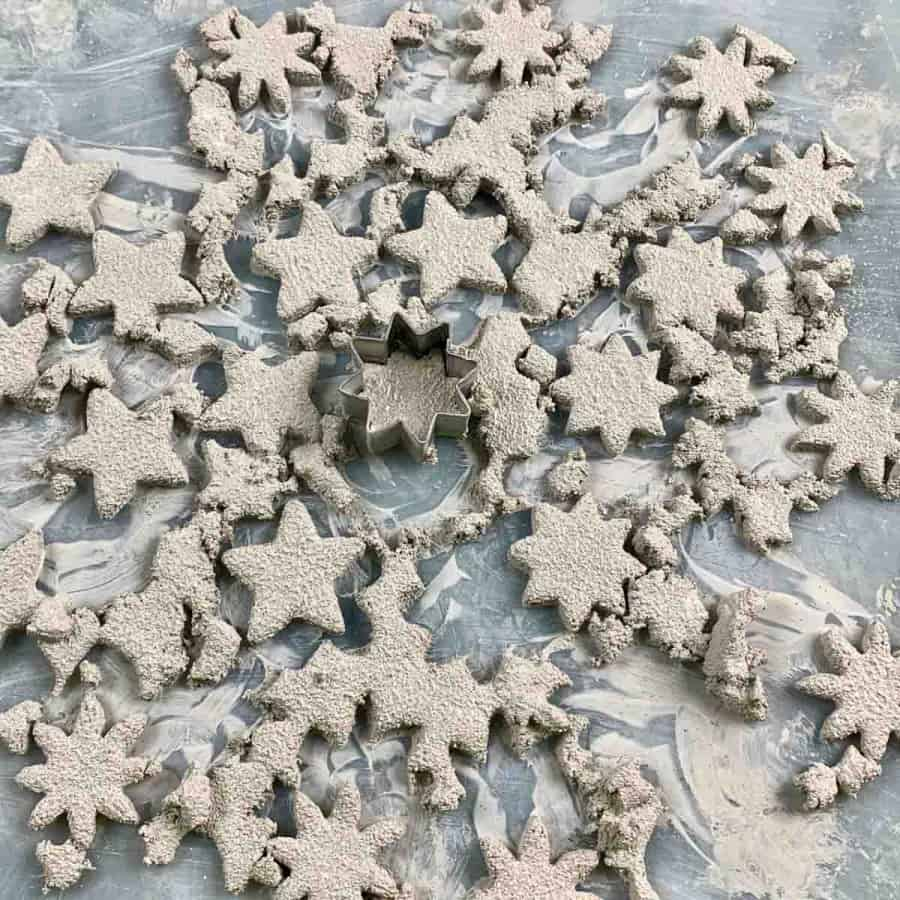 cut pieces of cement for gift tags with cookie cutter