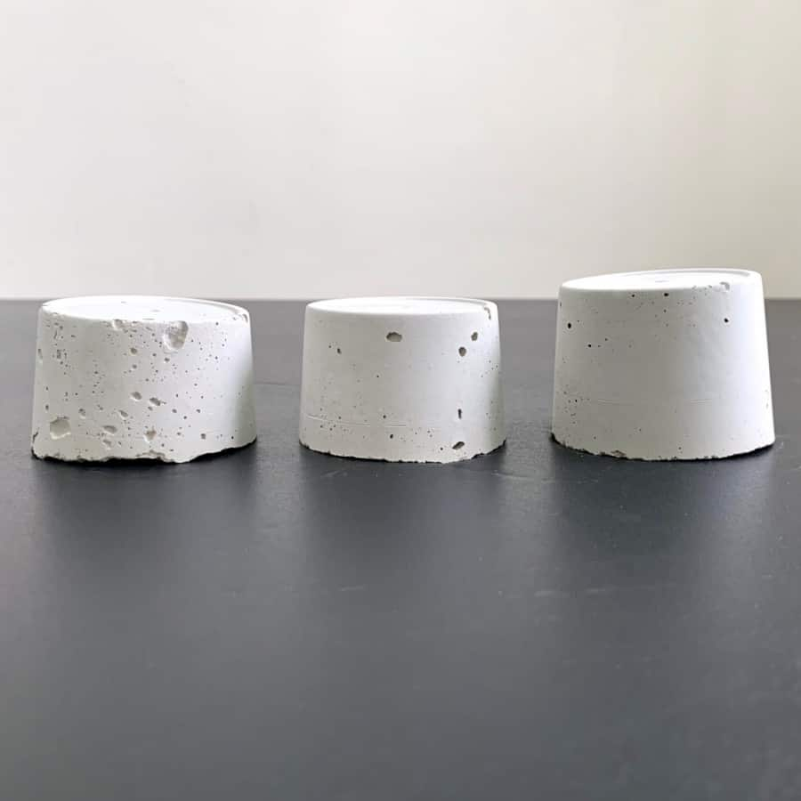 3 cement pieces with pinholes and pitting