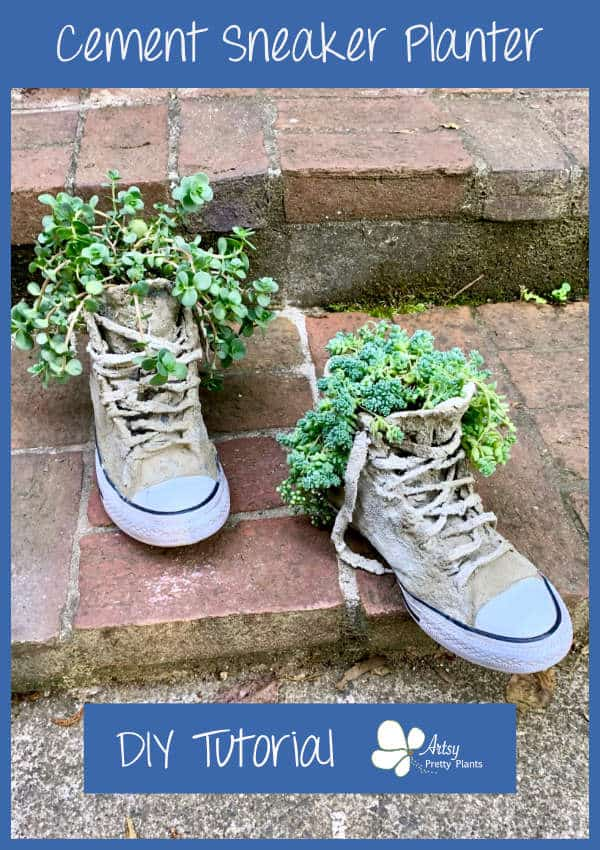 Cement sneakers on stairs with plants inside