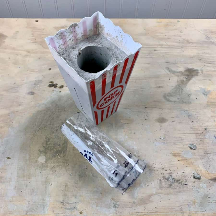 removing inner mold from container for DIY Cement Vase & Cat Design