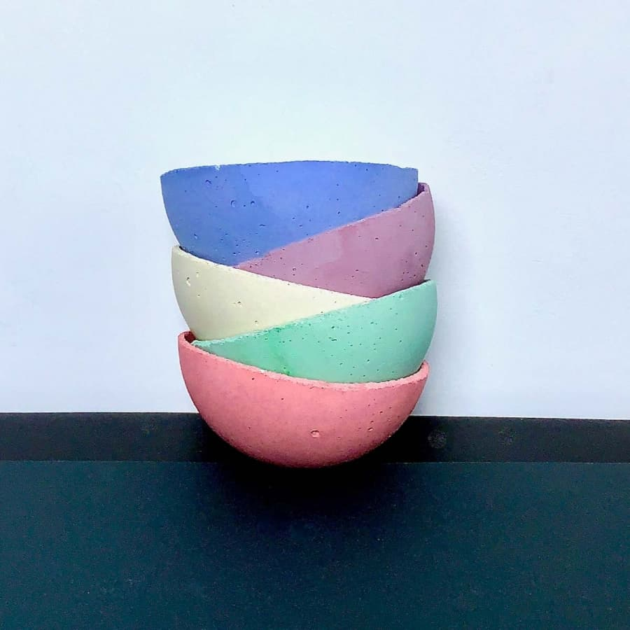 multi- colored dishes from cement crafts pigment