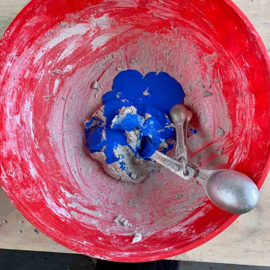 cement mixture with acrylic paint ready to be mixed in
