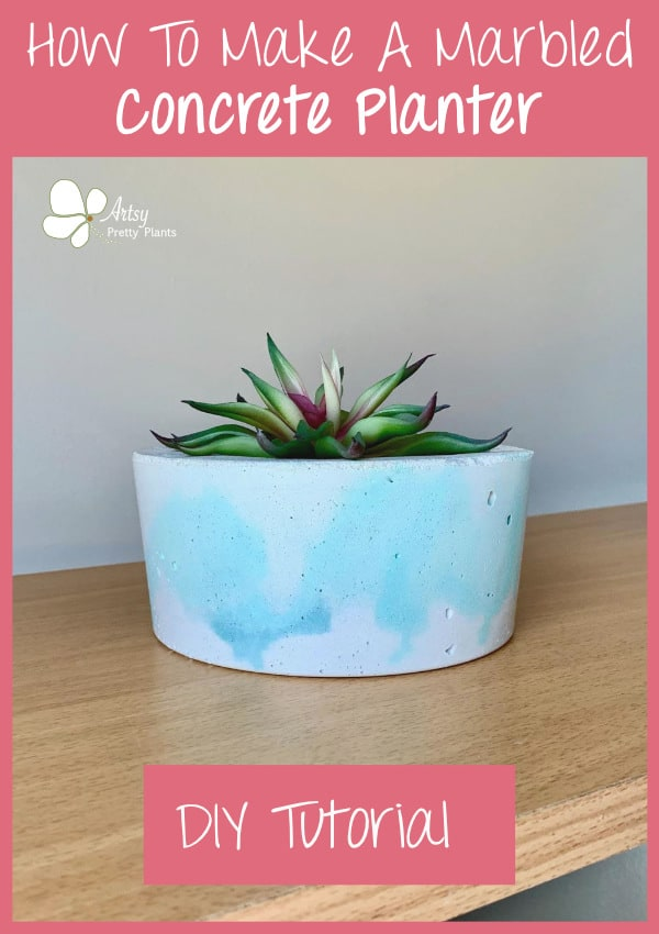 a marbled planter made with cement on a shelf