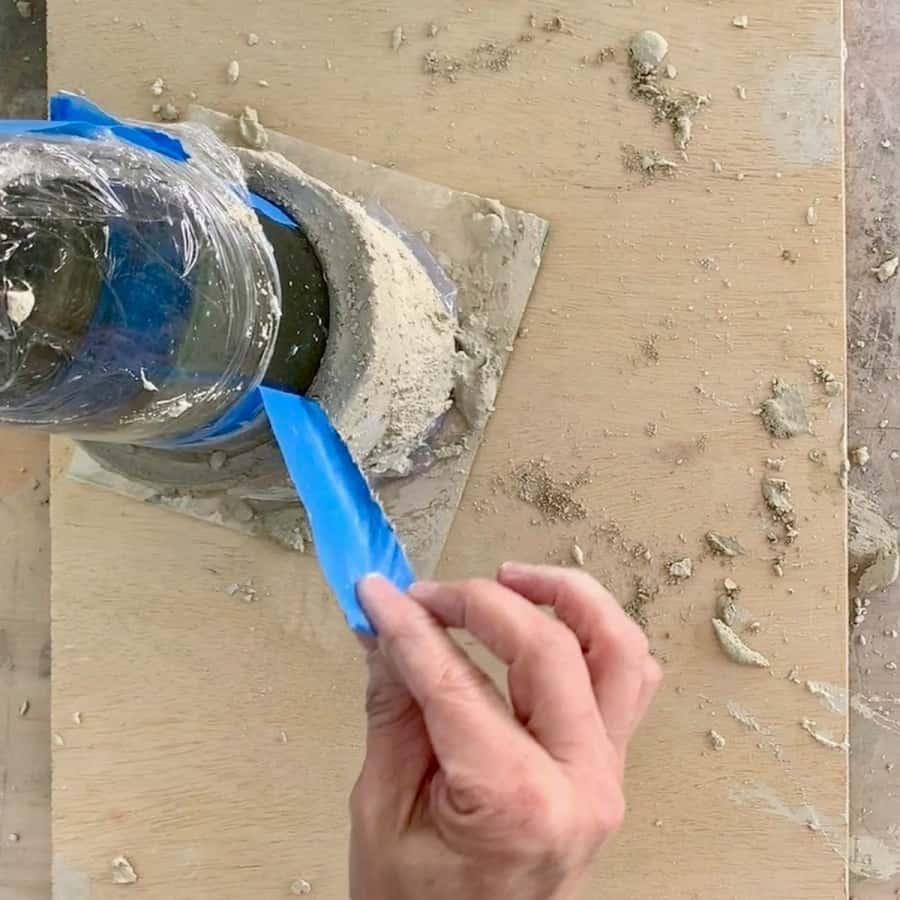 remove tape running around wine bottle