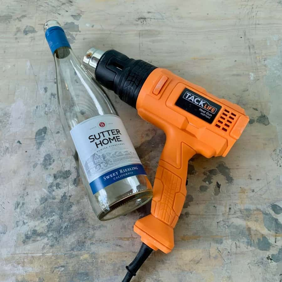heat gun and wine bottle with label
