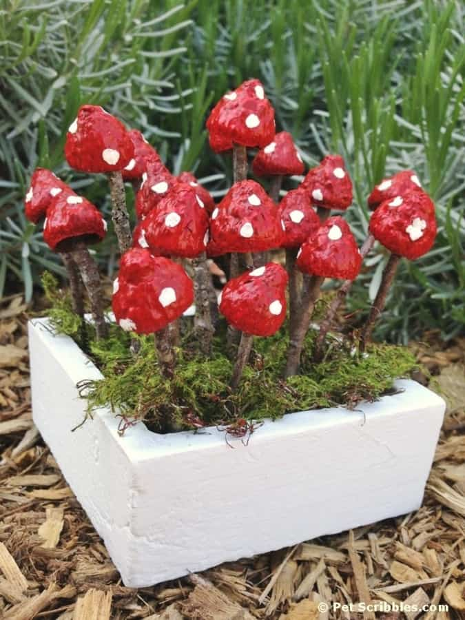 mushrooms painted in a garden- easy garden crafts