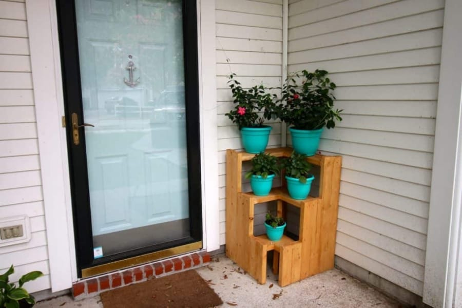 corner tiered wood planter stand tutorial with turquoise pots