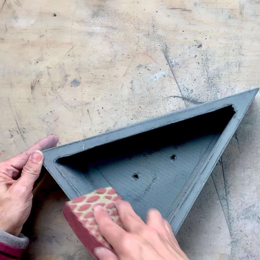 sanding edges of cement planter