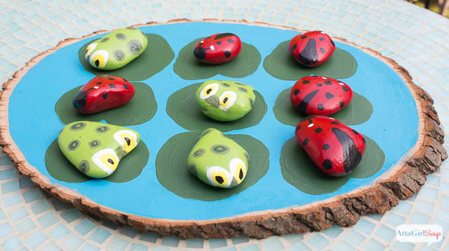 tic tac toe game on wood with ladybugs and frogs