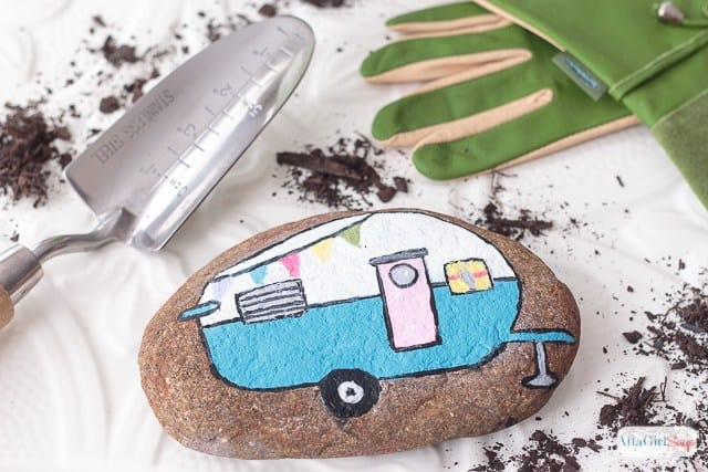 rock with camper painted on it