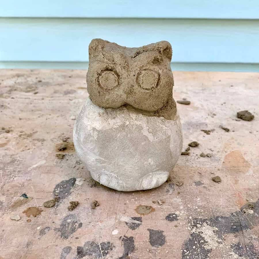 cement owl carved, head mortared to body