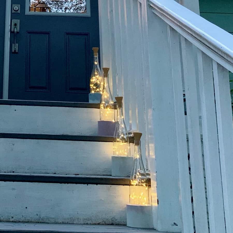 wine bottle lights on steps to door