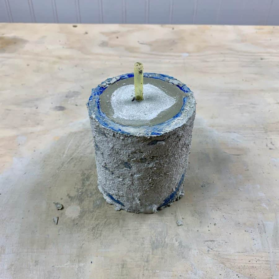 cement planter curing in mold with drainage straw inserted