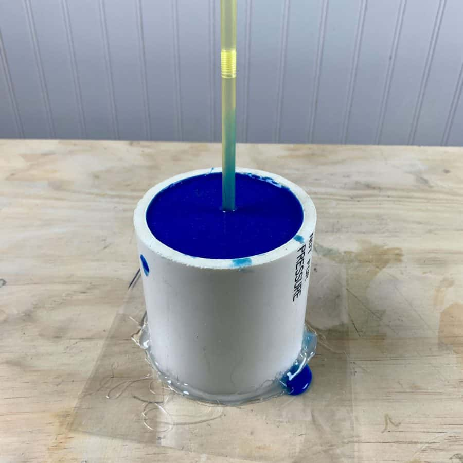 silicone poured for cement pot with drainage straw inserted