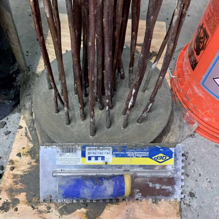 trowel leveling concrete off top of twig mold