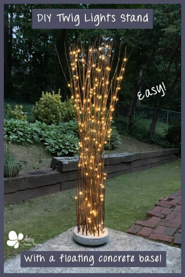 diy twig lights stand in yard