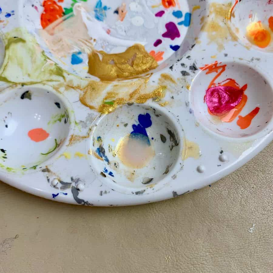 metallic paint mixed with water in paint dish