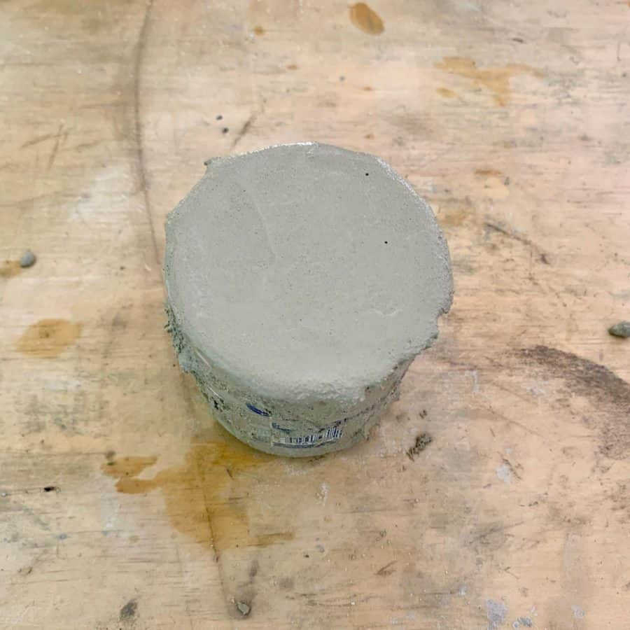 concrete filled to top of concrete holder mold for fall decor