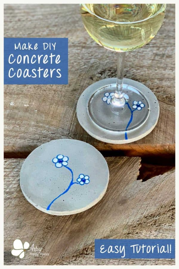 cute DIY concrete coasters with flowers on them and a glass of wine