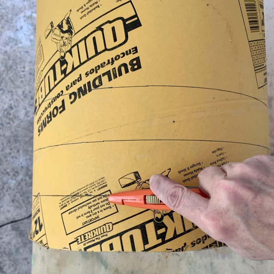 cutting cardboard tube for diy concrete side table mold with box cutter
