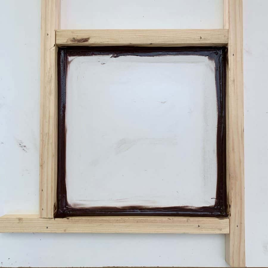 frame for outdoor tile mold with caulk smoothed in corners