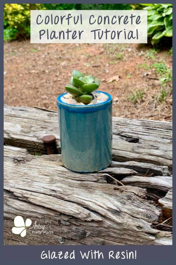 concrete diy planter from a silicone mold on a railroad tie. Glazed in blue resin.